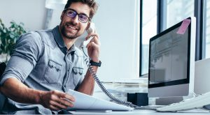 Net Affinity Man using VoIP Phone